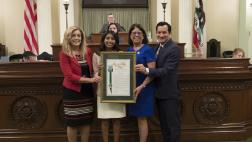 Assemblymember Aguiar-Curry and Speaker Rendon Present Assembly Resolutions to Assembly Fellows Puja Navaney on the Assembly Floor
