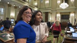 Assemblymember Aguiar-Curry and Assembly Fellow Puja Navaney on the Assembly Floor