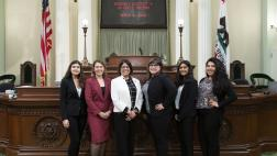 Assemblymember Aguiar-Curry on the Assembly Floor with her district office interns