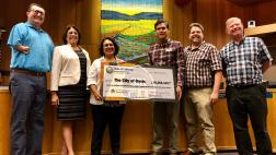 Assemblymember Aguiar-Curry presents check for $19,268,349 to Davis City Council - Will Arnold, Gloria Partida, Mayor Brett Lee, Lucas Frerichs, Dan Carson