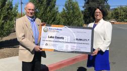 Assemblymember Aguiar-Curry presents check for $39,665,371 to Board Chair Supervisor Jim Steele of Lake County