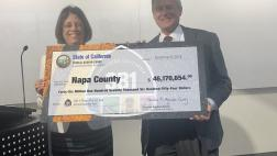 Assemblymember Aguiar-Curry presents check for $46,170,654 to Board Chair Supervisor Brad Wagenkecht of Napa County