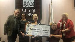 Assemblymember Aguiar-Curry presents check for $22,600,647 to Napa City Council - Scott Sedgley, Mayor Jill Techel, Jim Krider, and Doris Gentry