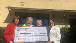 Assemblymember Aguiar-Curry presents check for $11,791,703 to Rohnert Park City Council - Gina Belforte, Jack Mackenzie, and Mayor Pam Stafford