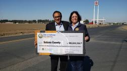 Assemblymember Aguiar-Curry presents check for $105,533,134 to Supervisor John Vasquez of Solano County