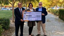 Assemblymember Aguiar-Curry presents check for $65,966,440 to Yolo County Supervisors Jim Provenza and Don Saylor